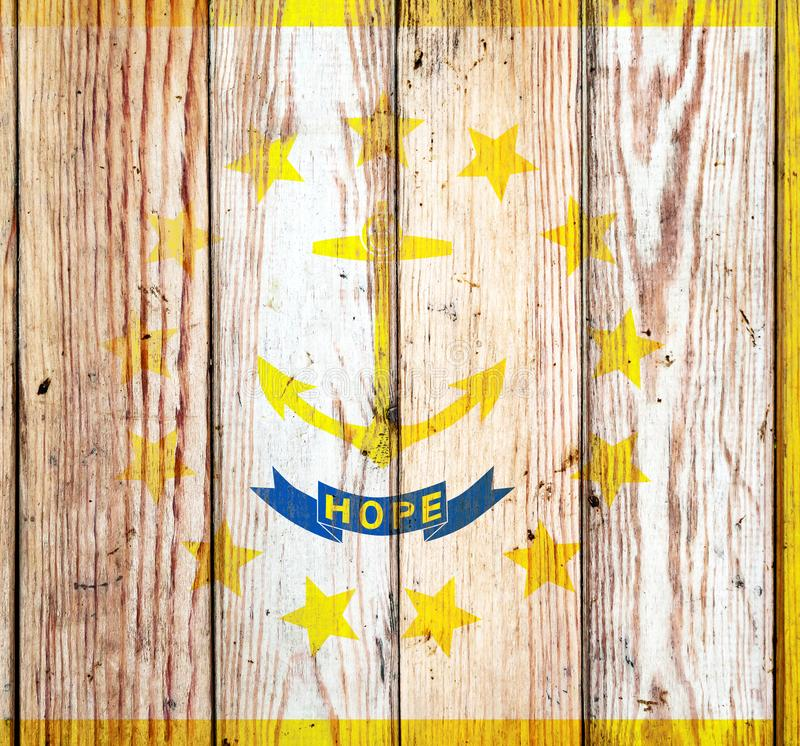 Rhode Island US state national flag on a gray wooden boards background on the day of independence in different colors of blue red. And yellow. Political and stock image