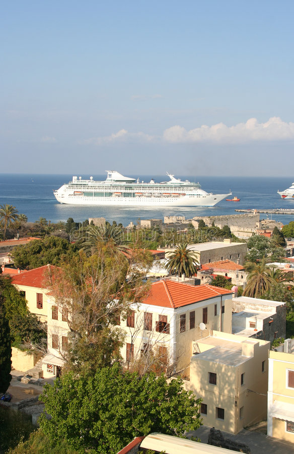 Rhodes. View of Rhodes rooftops and trees, ship in the distance stock photos