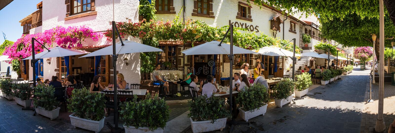 RHODES, GREECE - JUNE 29 2018: People relaxing in traditional. Restaurant in city of Rhodes royalty free stock image