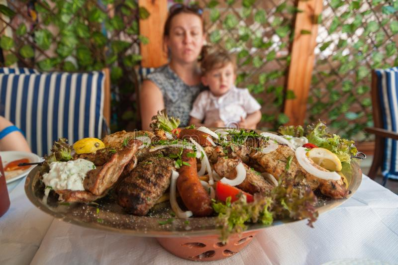 Rhodes, Greece. May 30, 2018. Meze plate with traditional local food on table in local restaurant in front of a family. Old Town, stock photos
