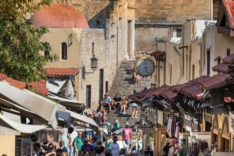 View of a main commercial steet and souvenirs market inside the old town of Rhodes, Greece. Rhodes, Greece - October 10th, 2018: View of a main commercial steet royalty free stock photography