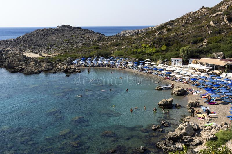 Rhodhes island, summer day on the Ladiko beach plenty of sunbeds and umbrellas, Aegean sea, Dodecanese Islands, Greece. Rhodes island, Greece - September 5, 2018 royalty free stock photography