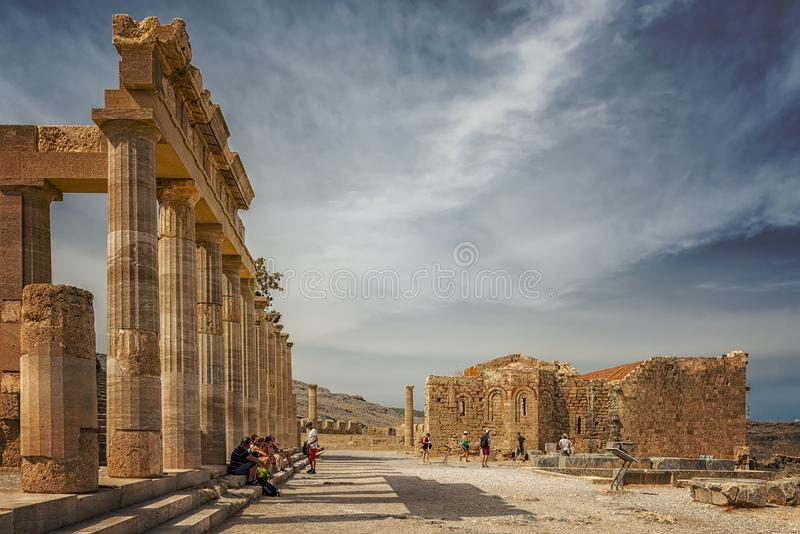 Rhodes Lindos Acropolis Editorial. LINDOS, GREECE - OCTOBER 04, 2018: The ruins of this ancient citadel at Lindos sits proudly atop a steep cliff with sea views stock photo