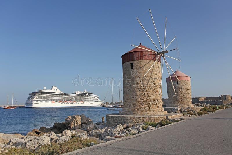 Rhodes Mandraki harbour wind mills. Greece. Rhodes Mandraki harbour wind mills. September 2015 royalty free stock photo