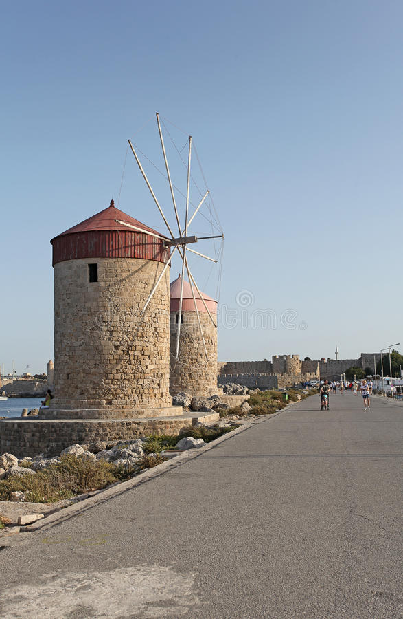 Rhodes Mandraki harbour wind mills. Greece. Rhodes Mandraki harbour wind mills. September 2015, Greece stock image