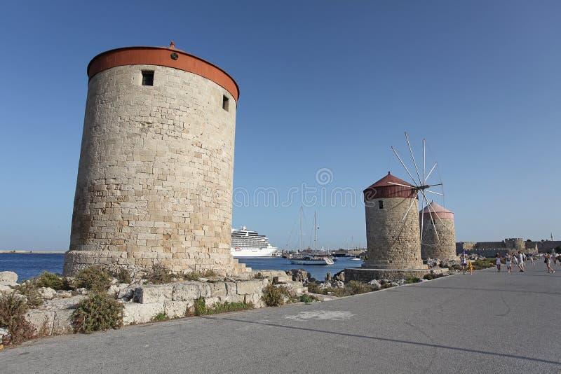 Rhodes Mandraki harbour wing mills. Greece. Wing mills in Rhodes Mandraki harbour. September 2015, Greece stock images