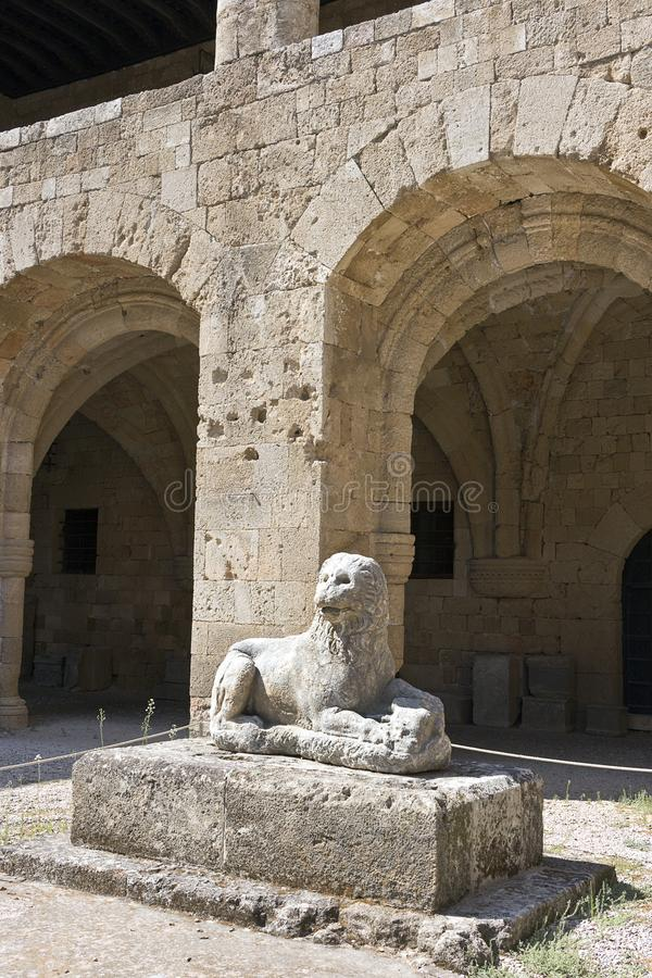 Rhodes Old City - Archaeological museum, old Hospital of the Knights of Saint John. Main courtyard and lion statue. Dodecanese Isl royalty free stock photography