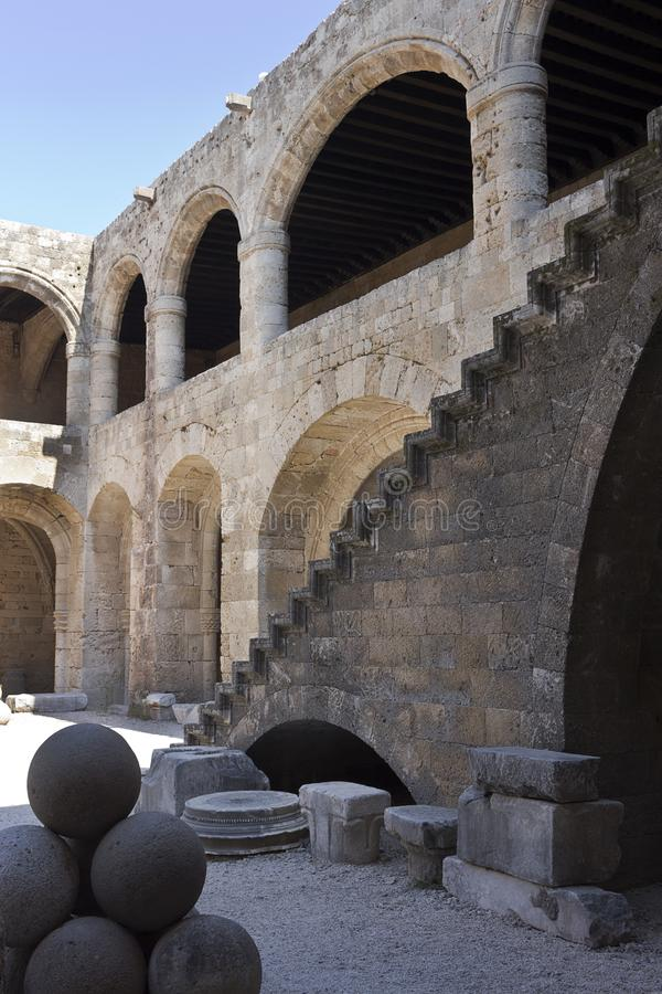 Rhodes Old City - Hospital of the Knights, the main courtyard. The outside stairway leads to the upper floor.  Archaeological muse stock photo
