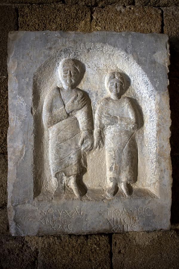 Rhodes Old City - Male and female hand in hand, grave stele from Nisyros,  Archaeological museum, Dodecanese Islands, Greece royalty free stock photography