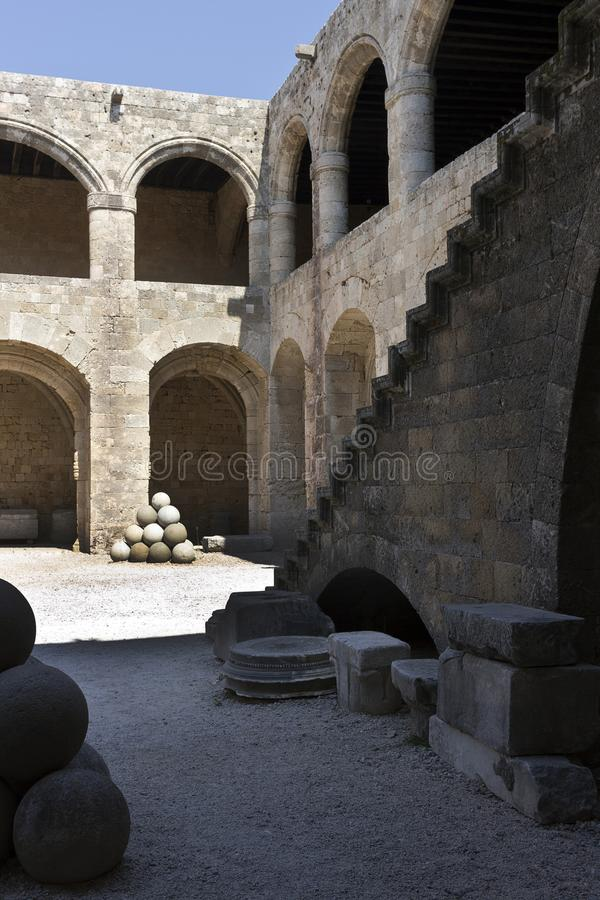Rhodes Old City - Outside stairway, cannon ball in the main courtyard of  Hospital of the Knights. At present Archaeological museu stock photography
