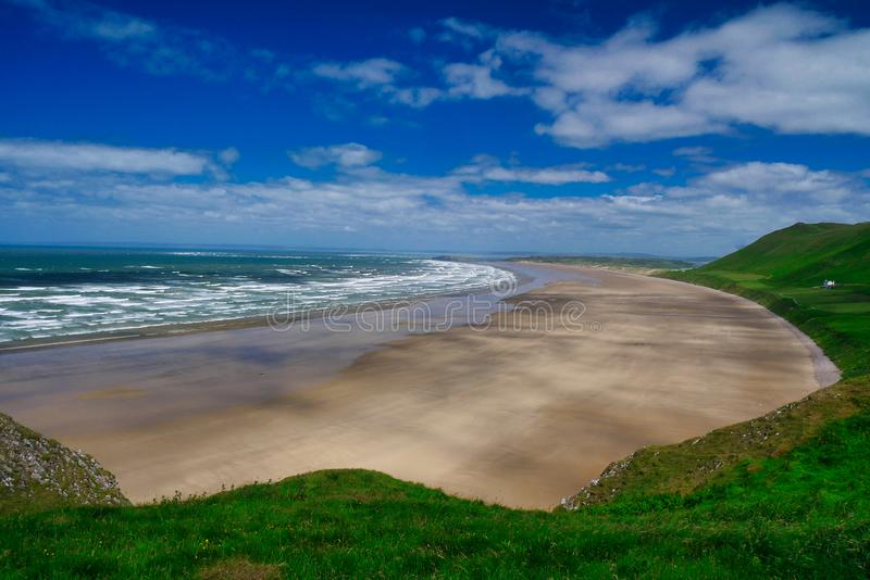 Rhossili Bay beach on the Gower Peninsula in South Wales in the UK, on a sunny day in summer.  stock photos