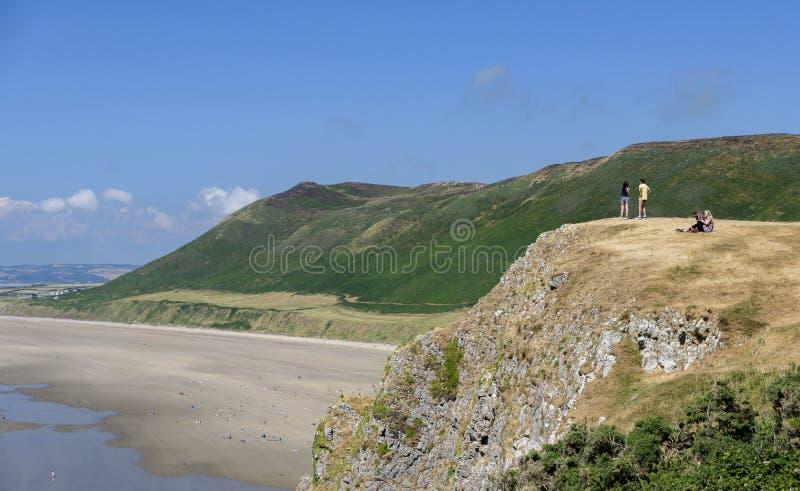 Rhossili fjärd, Goweren, Wales, på en solig sommardag royaltyfri bild