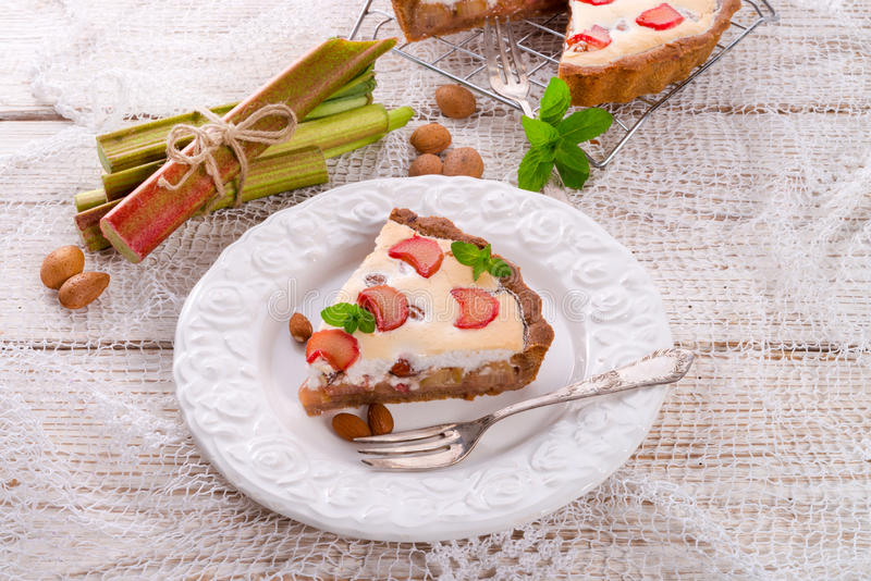 Rhubarb cakes with meringue and almonds. A rhubarb cakes with meringue and almonds royalty free stock image