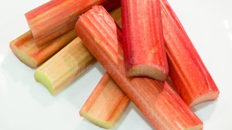 Rhubarb cut in pieces stock photos