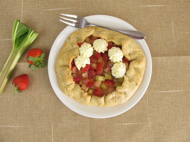 Rhubarb strawberry galette with white chocolate cream stock photos