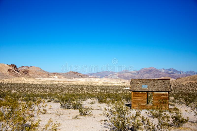 Rhyolite Ghost town near Beatty USA. Rhyolite is a ghost town in Nye County, in the U.S. state of Nevada. It is in the Bullfrog Hills, about 120 miles northwest royalty free stock photography