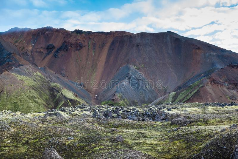 The rhyolite mountains. The picturesque valley surrounded by rhyolite mountains. Summer morning in the National Park Landmannalaugar, Iceland stock photos