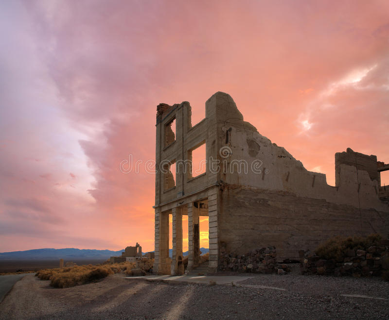 Rhyolite Ruins And Sunset. A Crumbling Structure Under Restless Sunset Skies At Rhyolite Nevada, An Abandoned Town Near Death Valley, USA stock photos