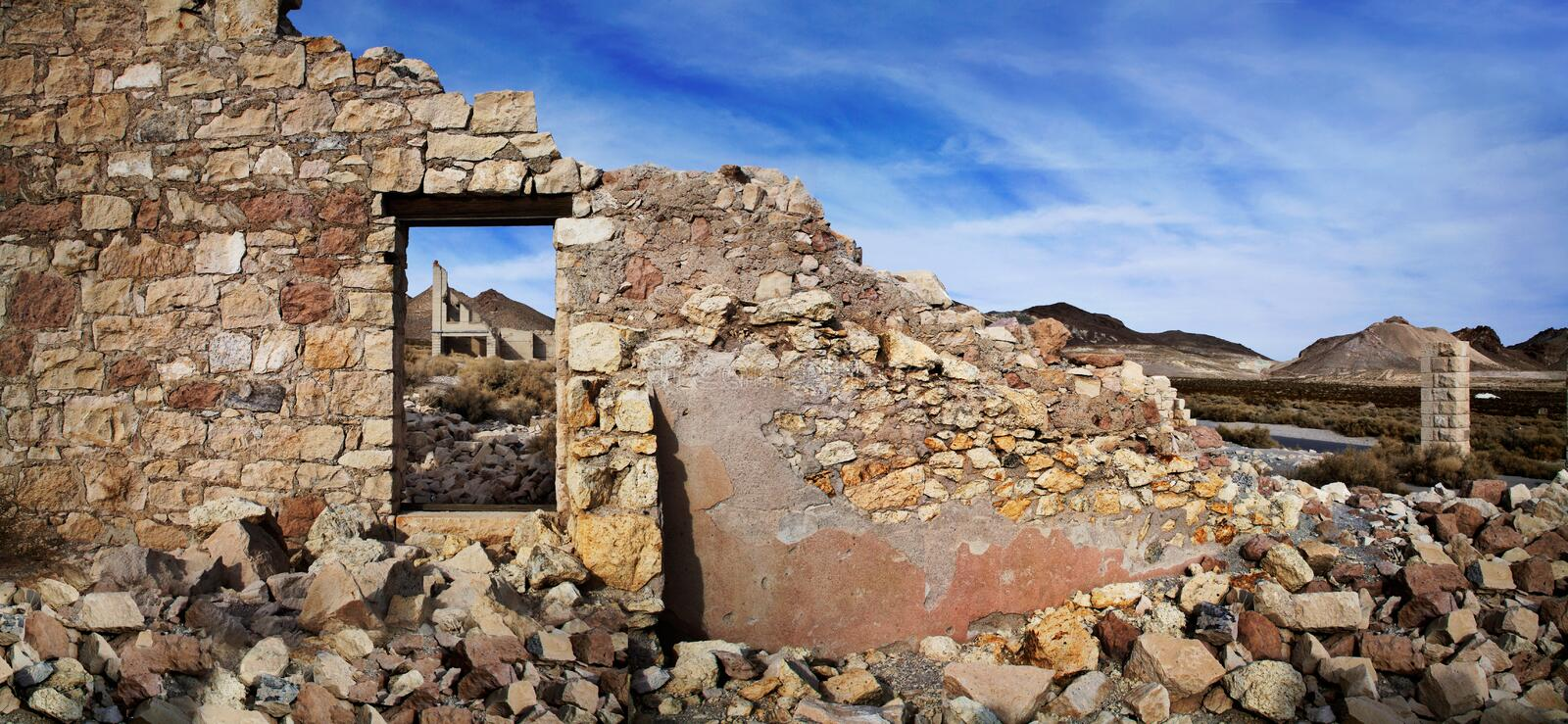 Rhyolite Ruins. The Wall And Window Of A Crumbling And Ruined Building At Rhyolite Nevada, An Abandoned Town Near Death Valley California, USA royalty free stock photos