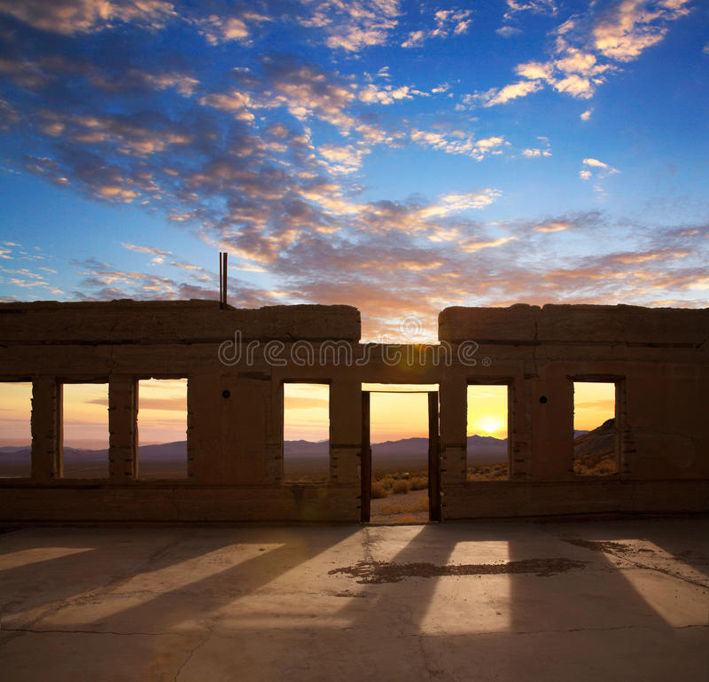 Rhyolite Sunset. Sunset Through The Windows Of A Roofless And Crumbling Building Overlooking The Amargosa Valley At Rhyolite Nevada, An Abandoned Town Near Death royalty free stock photo