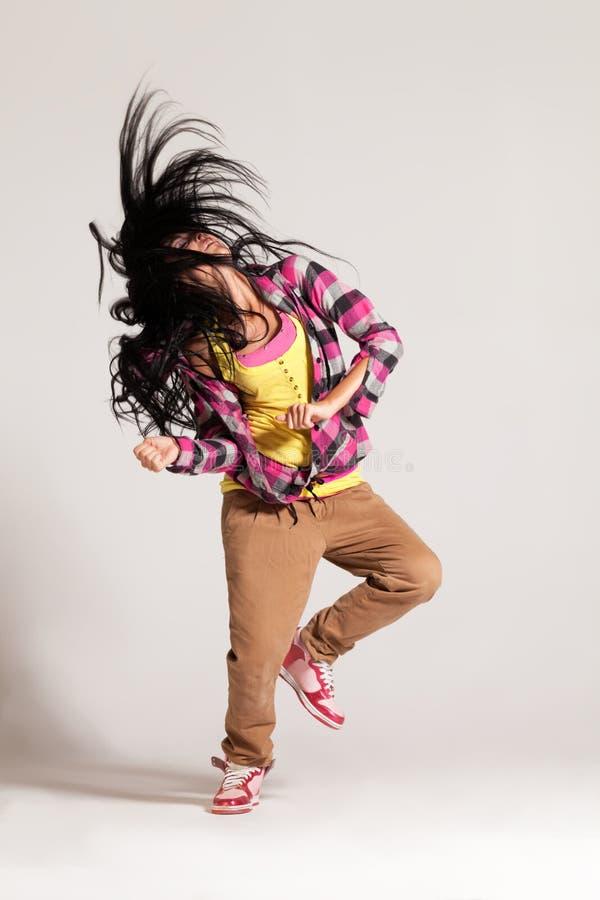In the rhythm. Girl enjoying the hip-hop dance stock photo