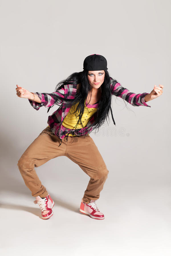In the rhythm. Girl enjoying the hip-hop dance stock photography