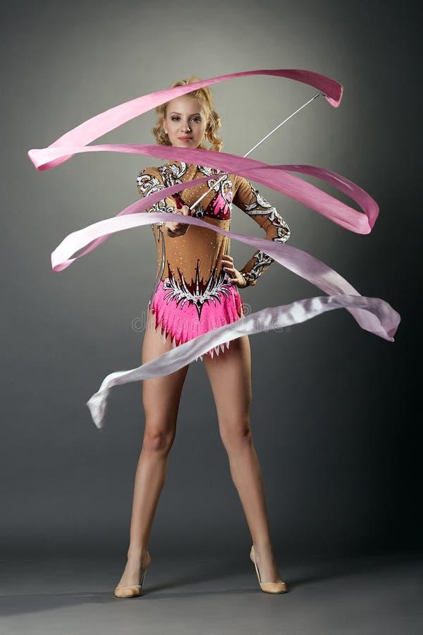 Rhythmic gymnastics. Cute girl dancing with ribbon royalty free stock image