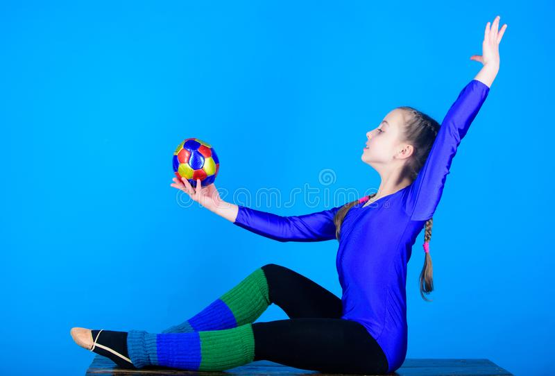Rhythmic gymnastics sport combines elements ballet dance. Girl little gymnast sports leotard. Physical education and stock image