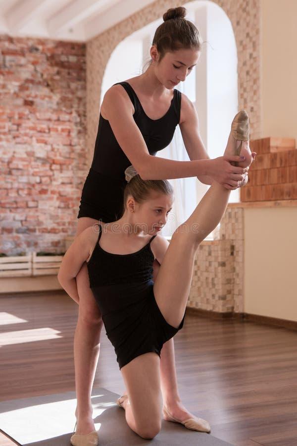 Rhythmic gymnastics. Young ballerinas teamwork stock photo
