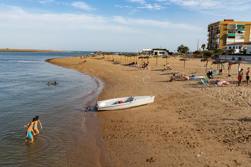 Ria beach in Punta Umbria, Huelva, Andalusia, Europe. A sunny summer day on vacation with lots of people and blue sky stock photos