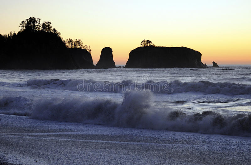 Rialto Beach, Olympic Peninsula, Washington state, USA. The sun sets on Rialto Beach in the remote Olympic Peninsula of Washington state, USA royalty free stock photography