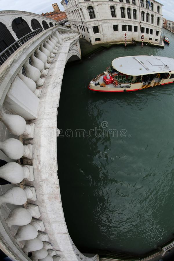 Rialto Bridge with fisheye lens and a ferry boat royalty free stock photos
