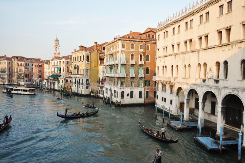 Rialto bridge and gondolas stock photography