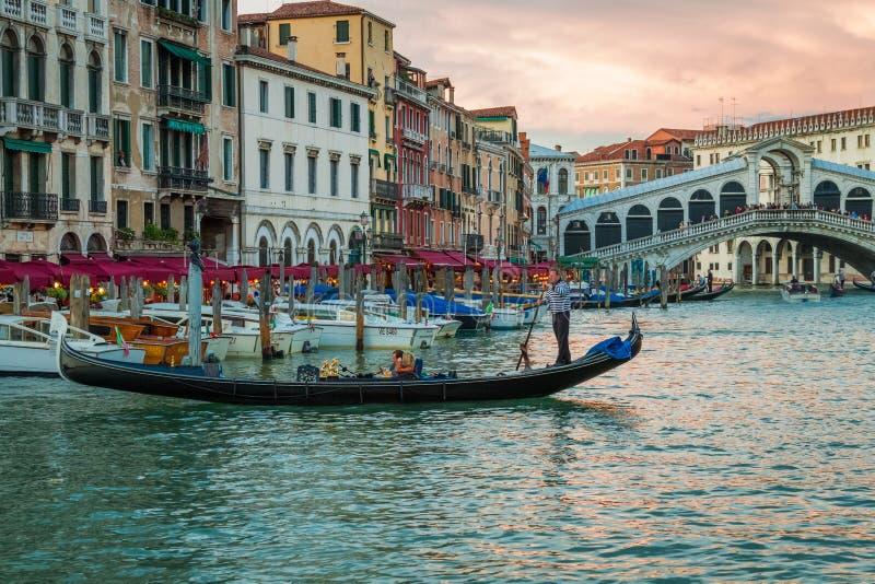 Rialto Bridge and restaurant in Venice royalty free stock photography