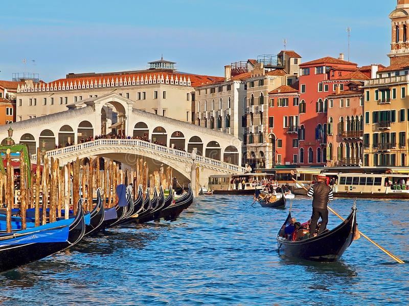 Cityscape of Venice with Rialto bridge and a gondola in front royalty free stock image