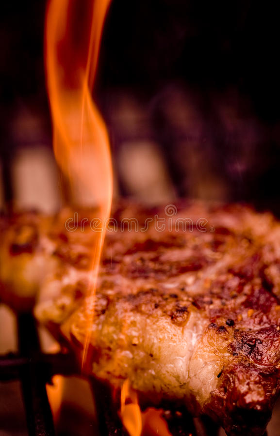 Rib Eye Steak on an open flame royalty free stock images