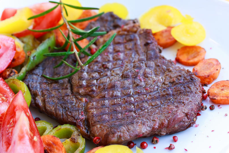 Rib Eye Steak with tomato,yellow bell peper royalty free stock photo