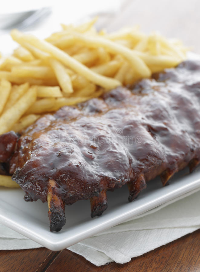 Rib meal with french frie stock images