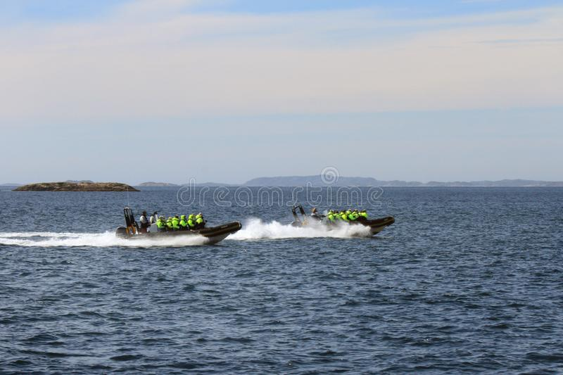 Rib Safari in the cold Arctic waters. Rib safari to watch sea eagles, whales and the famous trollfjord Lofoten Islands, Arctic Norway stock photography