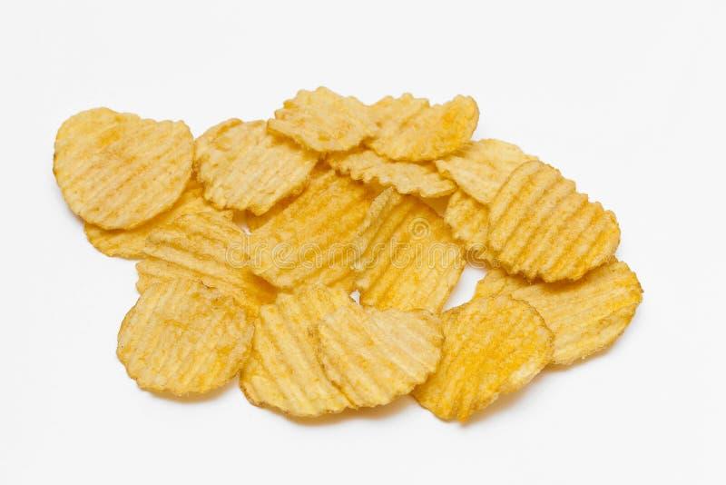Ribbade potatischiper med kryddor arkivbilder