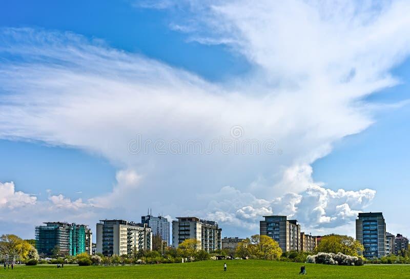 Ribban. Sunshine and thundercloud over city skyline royalty free stock photo