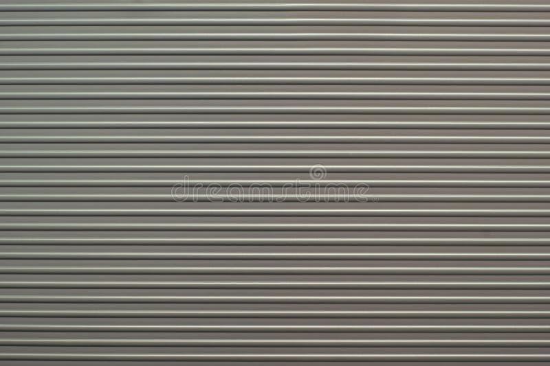 Ribbed aluminium med remsan mönstrar arkivbild