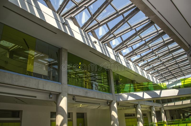 A ribbed,glass-framed ceiling that illuminates the entire interior at daylight at the International College in Dilijan stock photography