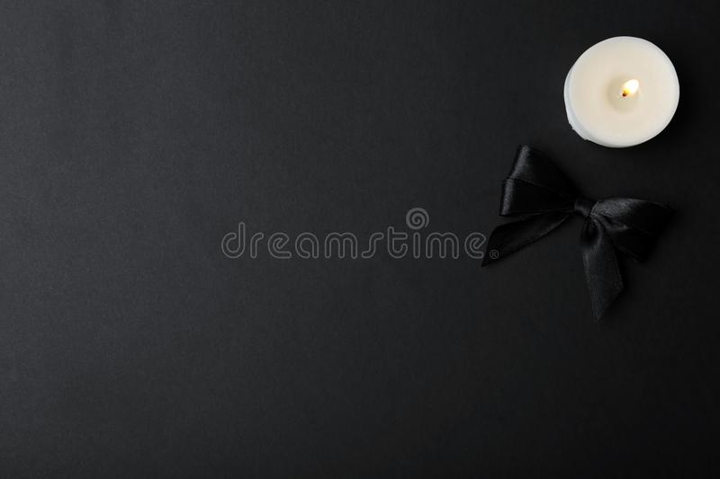 Ribbon and candle on black background, top view royalty free stock images