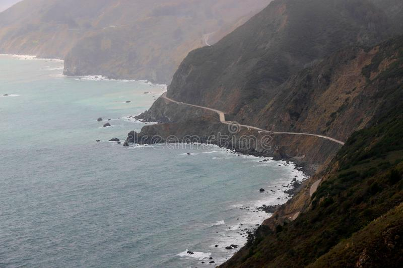 View from above of Highway 1, Big Sur, California. A ribbon of coastal road hugs the cliffs through Big Sur, CA stock photos