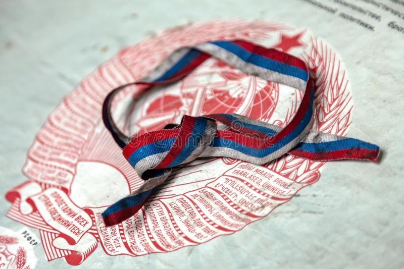 Ribbon of the flag of Russia and the coat of arms of the Soviet Union royalty free stock image