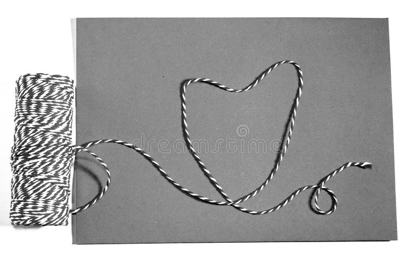 With a ribbon, red rope, white, envelope, meaning, love royalty free stock images