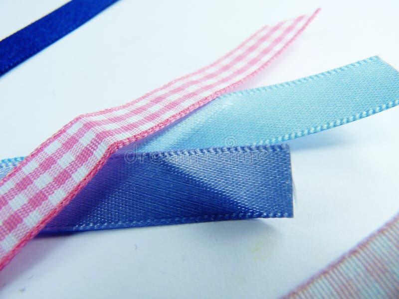 Ribbon samples close up pink and blue stock image