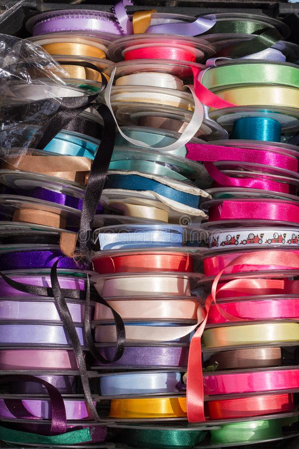 Coloured Ribbon Spools in the market royalty free stock photos