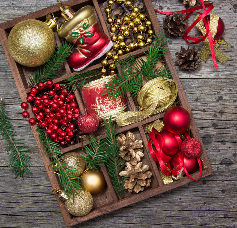 Ribbons, beads, toys, Christmas crafts in a wooden box. stock photos